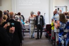 028 - Janet & Pete Walking Down Isle Married