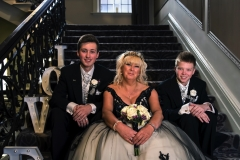 Elizabeth and boys on stairs 2